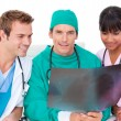 Stock Photo: Ambitious medical team looking at X-ray