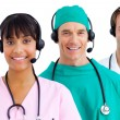 Happy medical team using headsets — Stock Photo