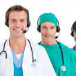 Smiling medical team using headsets — Stockfoto #10295848