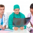 Serious medical team looking at X-ray — Stock Photo