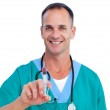 Portrait of a smiling doctor holding a syringe — Stock Photo #10295860