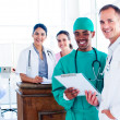 Stock Photo: Portrait of positive medical team at work