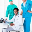 Stock Photo: Assertive male doctors looking at X-Ray