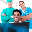 Stock Photo: Smiling male doctors looking at X-Ray