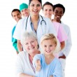 Stock Photo: Attentive medical team taking care of a senior woman and her gra