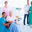 Attentive medical team taking care of a senior woman — Stock Photo #10295993