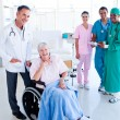 United medical team taking care of a senior woman — Stock Photo