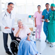 Stock Photo: United medical team taking care of a senior woman