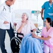 Confident medical team taking care of a senior woman — Stock Photo #10296000