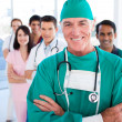 Multi-ethnic medical group smiling at the camera — Stock Photo