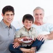 Smiling father and son visiting grandfather - Foto Stock