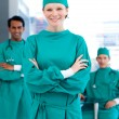 Confident surgeons smiling at the camera — Stock Photo #10296152