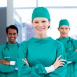 Positive surgeons with folded arms standing — Stock Photo #10296153