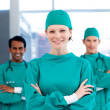 Positive surgeons with folded arms standing - Stock Photo