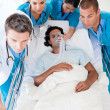 Stock Photo: Medical team carrying patient to intensive care unit