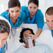 Emergency team carrying a patient — Stock Photo #10296172