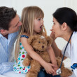 Doctor examining child's throat — Stock Photo