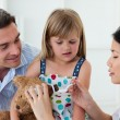 Serious female doctor giving medecne to a little girl — Stock Photo