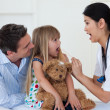 Little girl opening her mouth and the doctor checking her throat — Stock Photo