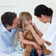 Female doctor examining little girl — Stock Photo #10296261