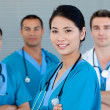 Medical team smiling at the camera — Stockfoto