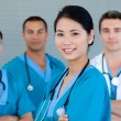 Medical team smiling at the camera - Stock Photo