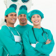 Smiling team of surgeon — Stock Photo #10296294