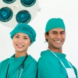 Stock Photo: Close-up of two ethnic surgeons