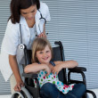 Female doctor pushing wheelchair — Stok Fotoğraf #10296339