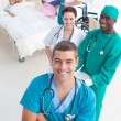 High angle of medical team attending to a young patient — Stock Photo #10296361