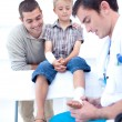 Doctor bandaging a child's foot — Stock Photo