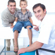 Stockfoto: Doctor checking boy reflexes