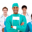 Confident surgeon with his team in the background — Stock Photo