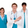 Young doctors smiling at the camera — Stock Photo