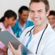 Young male Doctor Smiling at the camera — Stock Photo #10296491