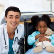 Foto Stock: Doctor helping sick child