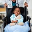 Young child being cared for by a doctor - Stock Photo