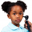 Afro-american little girl attending medical check-up - Stock Photo