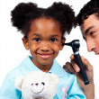 Confident doctor examining his young patient — Stock Photo #10296588