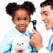 Stock Photo: Smiling doctor examining his patient's ears