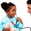 Caring doctor playing with his young patient - Stock Photo