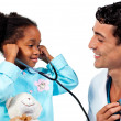 Smiling doctor and his patient playing with a stethoscope - Stock Photo