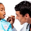 Stock Photo: Smiling doctor checking little girl's throat