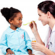 Adorable little girl taking medicine — Stock Photo
