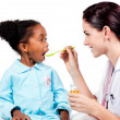 Female doctor giving medicine to her patient — Stock Photo #10296609