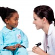 Adorable little girl attending medical check-up — Stock Photo #10296626