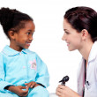 Smiling little girl attending medical check-up — Stock Photo #10296627