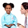 Cute little girl attending medical check-up — Stock Photo #10296628