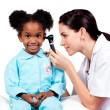 Female doctor checking her patient's ears — Stock Photo #10296629