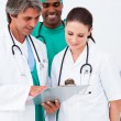 Medical team studying medical history — Stockfoto #10296690